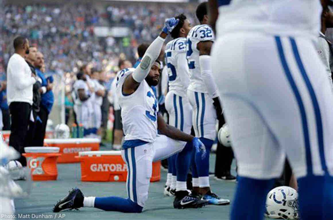 A member of the Indianapolis Colts taking a knee during the National Anthem